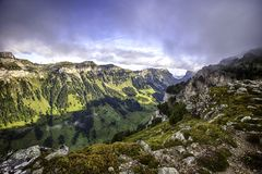 Bernese Alps from the top of Niederhorn in summer, Canton of Bern, Switzerland, wallpaper. Popular travel destination Mt Niederhorn, snow, beautiful stock photography