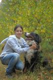 Bernese Mountain Dog and girl teenage girl Royalty Free Stock Photos