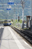 Bernese Oberland railway train arriving in Lauterbrunnen Stock Images