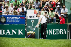 Bernhard Langer. Shoots his 1st shot, up toward the green, on the first tee box Royalty Free Stock Photos