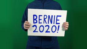 Bernie Sanders 2020 sign held up with alpha matte. Bernie Sanders 2020 hand made sign is held up - alpha matte included for keying stock footage