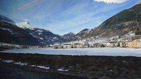 The Bernina Express Red Train passing through the Alps. The Bernina Express Red Train through the Alps in Winter stock video footage