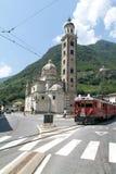 Bernina express train arriving at Tirano on Italy Stock Photos
