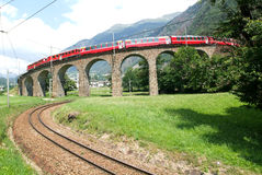 Bernina Express Train at Brusio on the Swiss alps Royalty Free Stock Photography