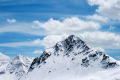 Bernina Group (Swiss Alps). Snowy Alps in Switzerland, Bernina Group, under cloudy sky royalty free stock photography