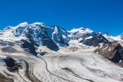 Bernina massive and glacier. Stunning view of the Bernina massive and Morteratsch glacier at the mountain house of Diavolezza in Engadine area of Switzerland Stock Photo