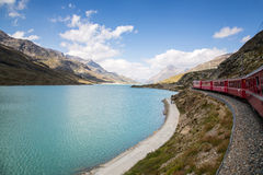 Bernina Railway. The Bernina railway is part of the Rhaetian Railway RhB. It links St. Moritz, in the Canton of Graubünden, Switzerland, with the town of stock photo