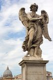 Bernini Angel. One of the Bernini Angels on the Ponte St Angelo in front the Castel St Angelo over the Tiber in Rome Stock Photography