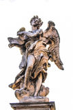 Bernini marble statue of angel with cross from the Sant Angelo Bridge in Rome Royalty Free Stock Photos