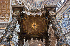 Bernini's baldachin in St Peter's Basilica. Detail of Bernini's baroque baldachin in St Peter's Basilica Rome Italy Stock Photos