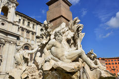 Bernini's famous Fountain of Four Rivers in Rome. Ganges, Danube and Nile statues from wonderful baroque Fountain of Four River in Piazza Navona Square designed Royalty Free Stock Images