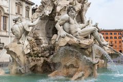 Bernini`s Fountain of the Four Rivers in empty Navona Square. Ho Stock Image