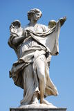 Bernini's marble statue of angel with cross from the Sant' Angelo Bridge in Rome Stock Images