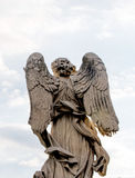 Bernini`s marble statue of angel in Rome, Italy. Bernini`s marble statue of angel from the Sant Angelo Bridge in Rome, Italy Stock Photo