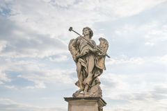 Bernini`s marble statue of angel. From the Sant`Angelo Bridge in Rome, Italy Royalty Free Stock Photos