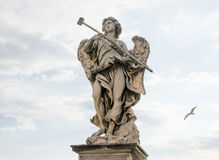 Bernini`s marble statue of angel. From the Sant`Angelo Bridge in Rome, Italy Stock Photography