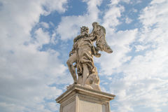 Bernini`s marble statue of angel. From the Sant`Angelo Bridge in Rome, Italy Stock Images