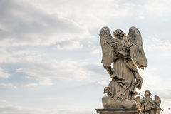 Bernini`s marble statue of angel. From the Sant`Angelo Bridge in Rome, Italy Royalty Free Stock Image