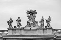 Bernini statues at the Vatican. A detail of Bernini`s colonnade in Saint Peter`s Square in Rome, Italy. Black and white photo Stock Image