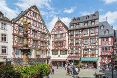 BERNKASTEL, GERMANY - JUL 21: Historic center of medieval city Bernkastel with unknown tourists on July 21, 2012 at Bernkastel, Ge Stock Photography