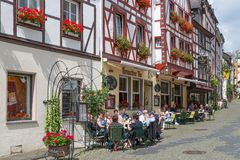 BERNKASTEL, GERMANY - JUL 21: Historic center of medieval city Bernkastel with unknown tourists sitting at several terraces  on Ju Royalty Free Stock Photography