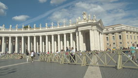 Bernni Collonade. Long line of people in front of the Bernini Colonnade at Saint Peter square, Vatican City time lapse stock footage