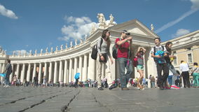 Bernni Collonade. Long line of people in front of the Bernini Colonnade at Saint Peter square, Vatican City time lapse stock video