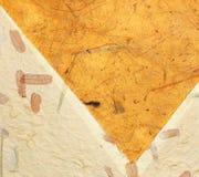 Bernsteinfarbiger und beige Papierhintergrund Stockfoto