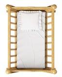 Berço de madeira do bebê com o descanso isolado no fundo branco, vista superior Imagem de Stock Royalty Free