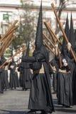 Berouwvol met zijn dwars, Heilige Week in het Broederschap van Sevilla Nazarene van studenten stock afbeelding