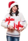 Überraschte glückliche Frau im Sankt-Hut Stockbild