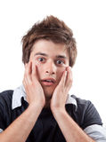 Überraschter erschrockener junger Mann getrennt auf Weiß Lizenzfreies Stockbild