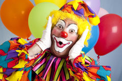 Überraschter Geburtstag-Clown Stockfotos