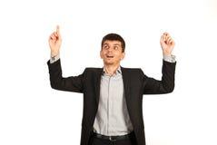 Überraschter Geschäftsmann, der oben zeigt Lizenzfreies Stockfoto
