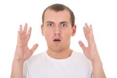 Überraschter junger Mann lokalisiert auf Weiß Lizenzfreie Stockbilder