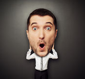 Überraschter Mann mit Großkopf Stockfotografie