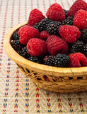 Berries. Fresh Raspberry and Blackberry in basket. Close-up Stock Image