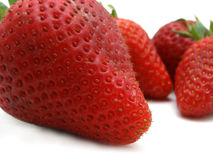 Berries. Super macro of strawberries on white background Royalty Free Stock Photography