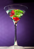 Berries alcohol  coctail. With mint on the table Royalty Free Stock Image