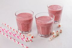 Berries and banana smoothie milkshake royalty free stock photography