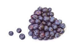 Berries of a bilberry formed into a heart shape- a Stock Image