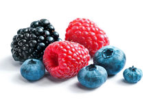 Berries blackberies, blueberries and raspberries. On white background. Close up, top view, high resolution product. Harvest Concept Stock Images