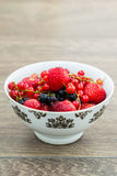 Berries. Bowl with strawberries, blackberry and red currant stock photos