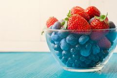 Berries bowl of strawberry blueberry Stock Photos