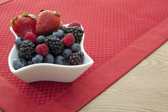 Berries in a bowl on the table Royalty Free Stock Photos