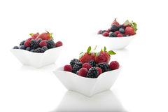 Berries in bowls Stock Photography