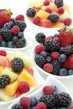 Berries in bowls stock images