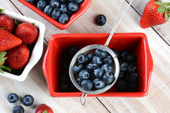 Berries in Bowls and Strainer Stock Photo