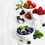 Berries in bowls  on Wooden Background. Stock Photo