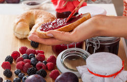 Berries and bread with jam. Berry jams and making sandwiches for second breakfast Stock Photography